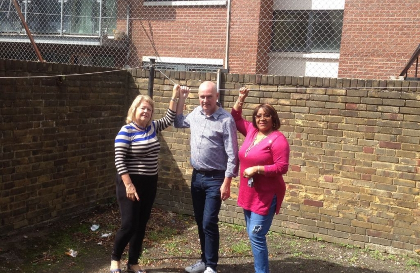 Cllr Carol Shaw, Cllr John Warren and Bertha Joseph inspecting the outside space at Frontenac